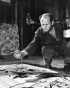 Artist Jackson Pollock dribbling sand on painting while working in his studio. (Photo by Martha Holmes/The LIFE Picture Collection/Getty Images)