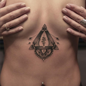 bang bang, chest tattoo on women's sternum