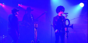 prince and kendrick lamar performing together on stage in purple lighting