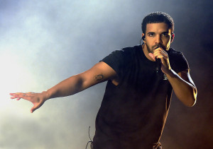 drake singing into a microphone
