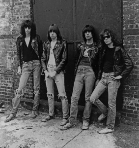 black and white phot of the ramones leaning against brick building