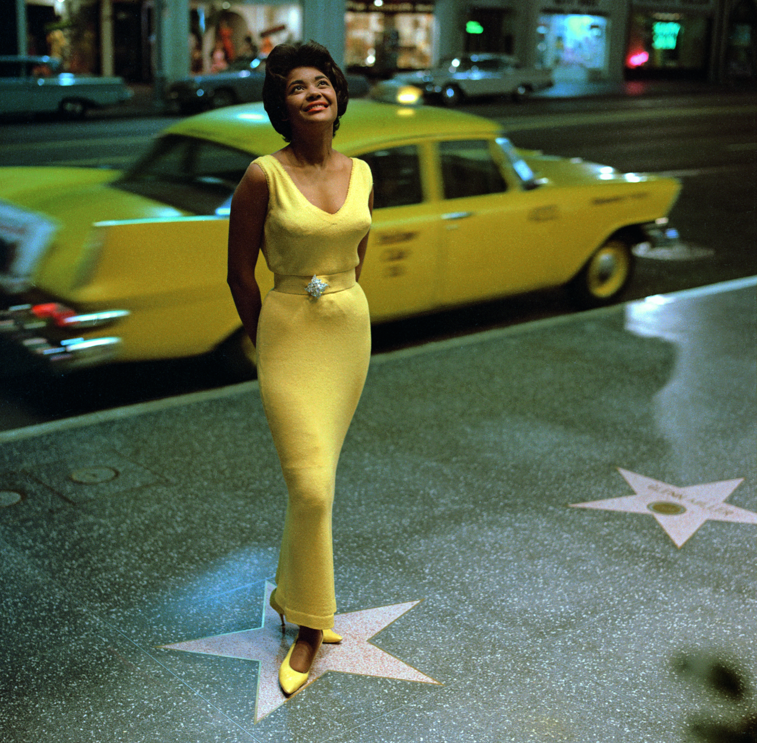 Jazz singer Nancy Wilson on Hollywood Boulevard. Photo by Ken Veeder, Hollywood, 1963. © Ken Veeder/Capitol Photo Archives.