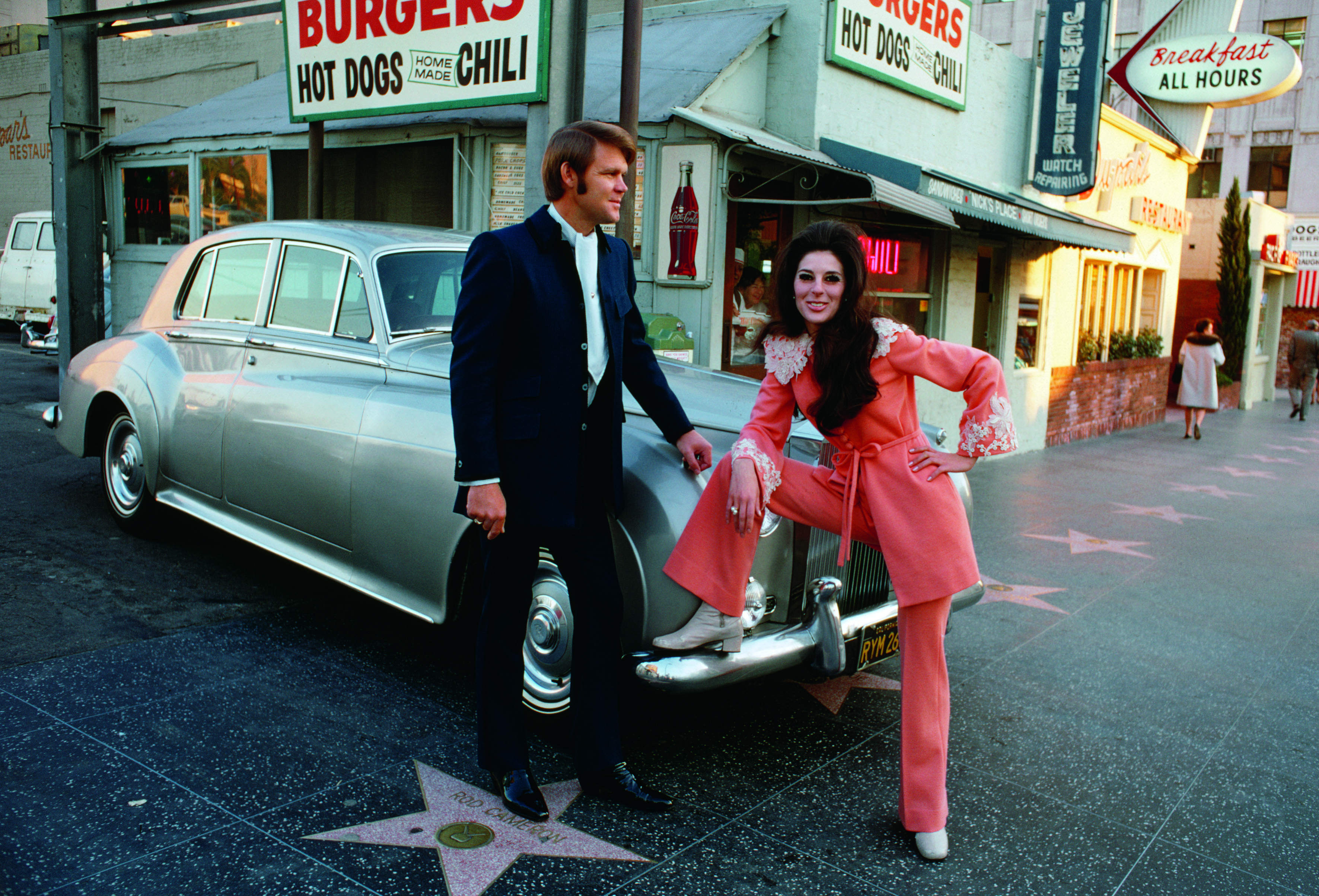 Glen Campbell and Bobby Gentry in front of Nick's Burgers on Hollywood Boulevard.