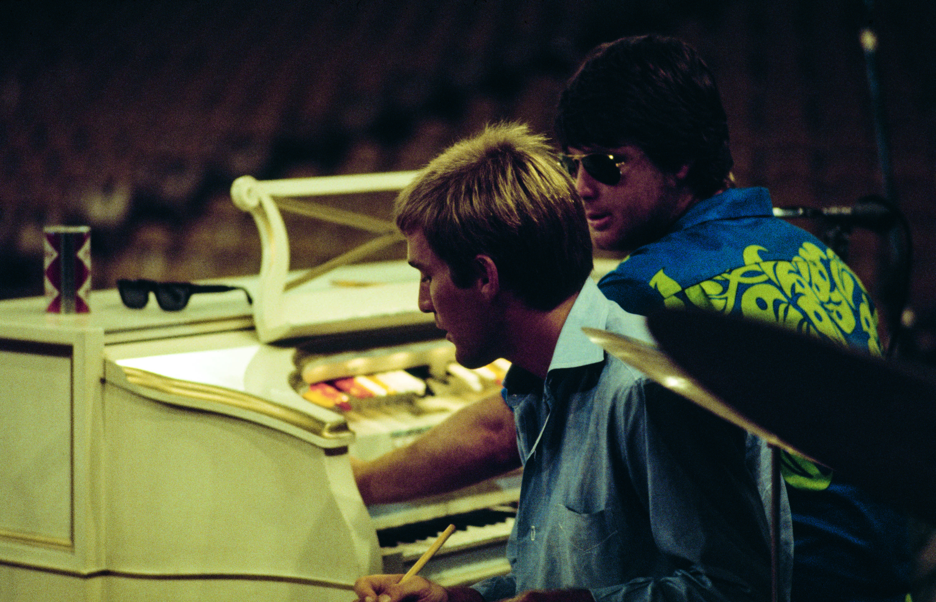 Beach Boys Dennis and Brian Wilson rehearsing for a concert in Hawaii. Honolulu International Center, August 25, 1967. © Capitol Photo Archives.