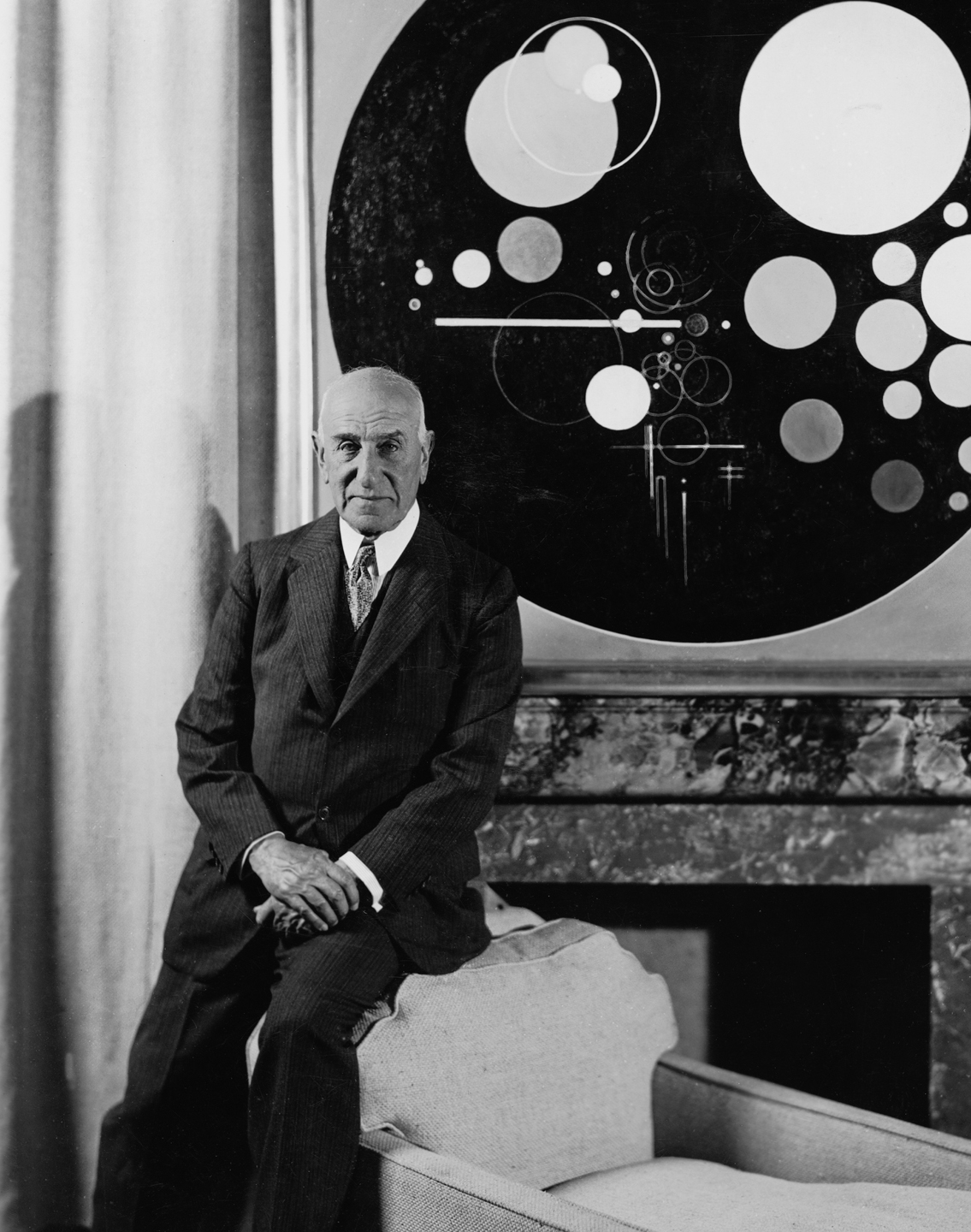 Solomon R. Guggenheim at the Plaza Hotel, New York, c. 1937, with Rudolf Bauer's Andante (from Tetraptychon: Symphony in Four Movements, 1926–30). Photo: Underwood and Underwood Studios, New York, courtesy HvRF Archives.