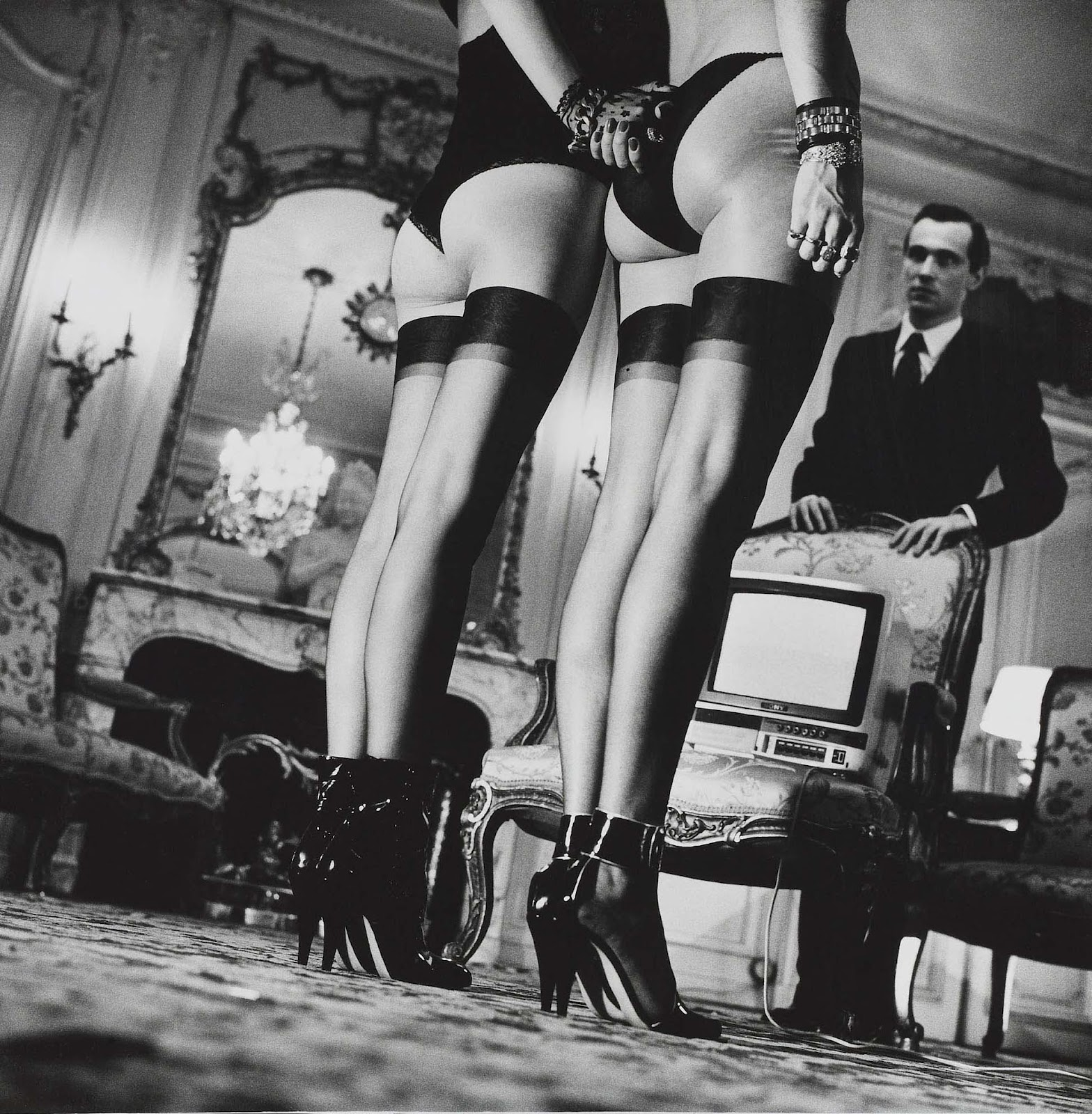Two Pairs of Legs in Black Stockings (1979) by Helmut Newton.