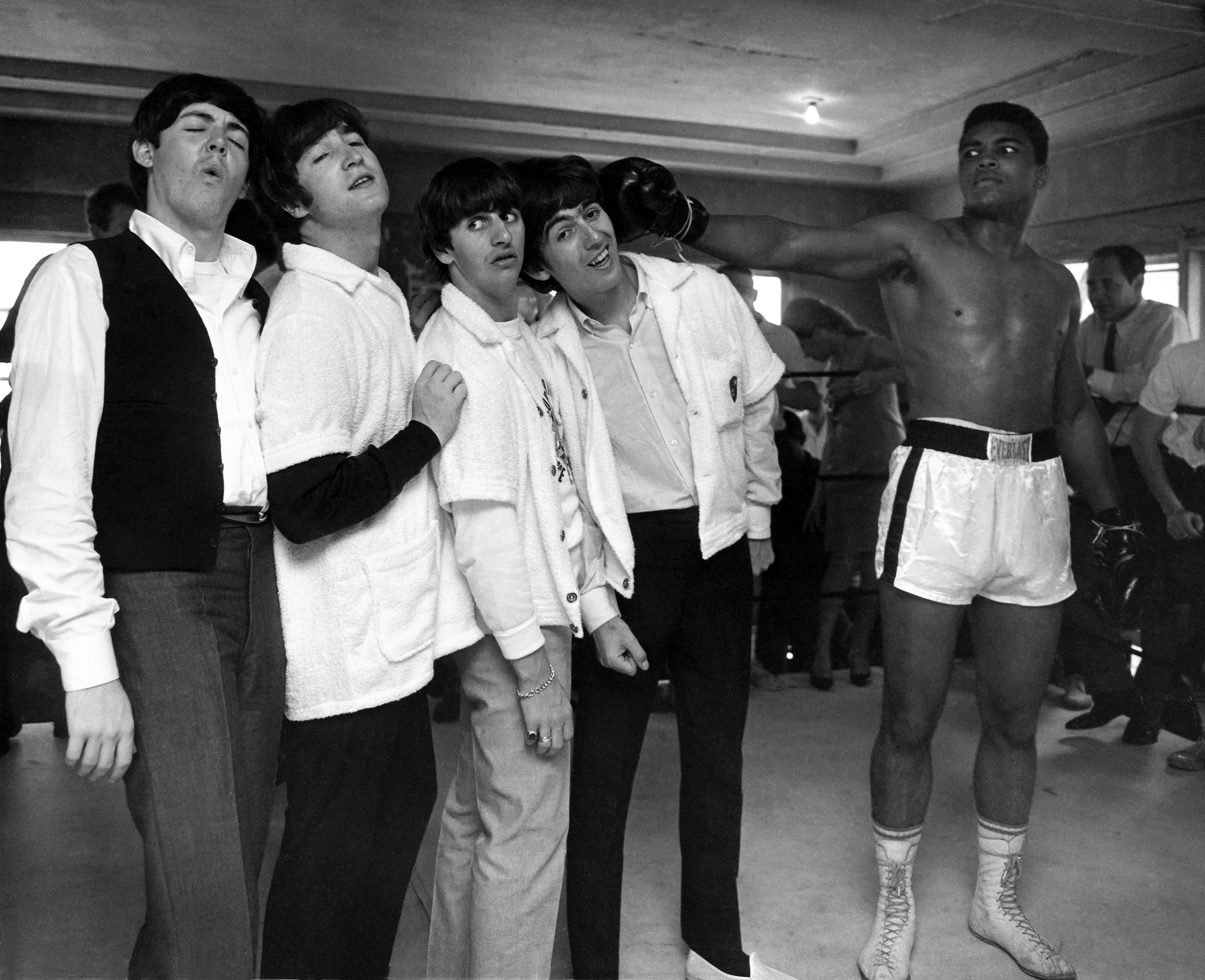 The Beatles and Muhammad Ali in HARRY BENSON: SHOOT FIRST, a Magnolia Pictures release. Photo courtesy of Magnolia Pictures. Photo Credit: © Harry Benson.